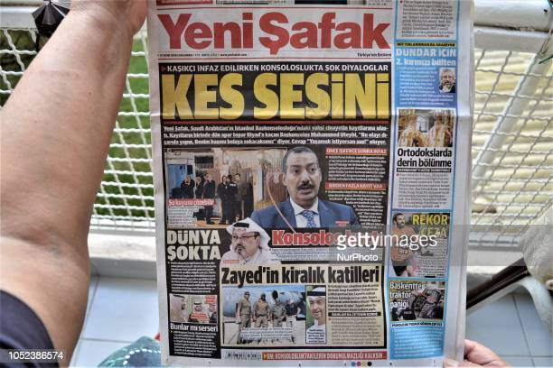 A woman reads Yeni Safak a Turkish progovernment daily newspaper as the daily runs a headline on its front page that reads 'Shut up' with a picture...