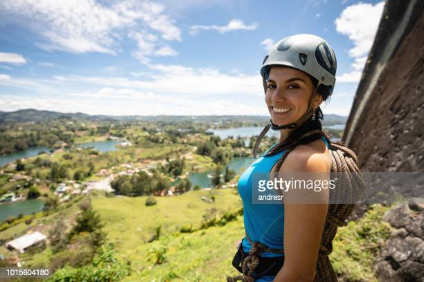 woman ready for rock climbing at guatape in colombia - guatapé stock pictures, royalty-free photos & images