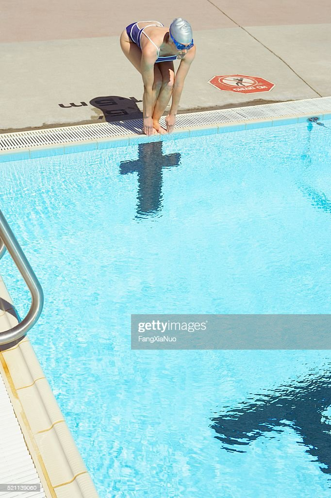 Woman Ready To Dive Into Swimming Pool : Stock Photo