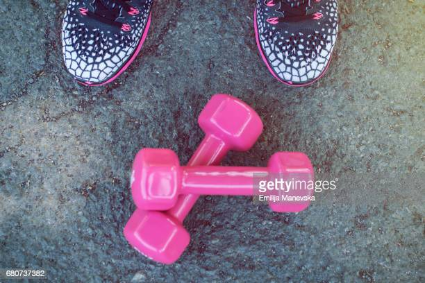 Woman ready to exercise with dumbbell