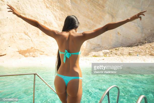 woman ready to jump into water - yacht stock pictures, royalty-free photos & images
