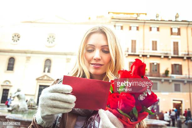 Woman receive a bouquet of red roses