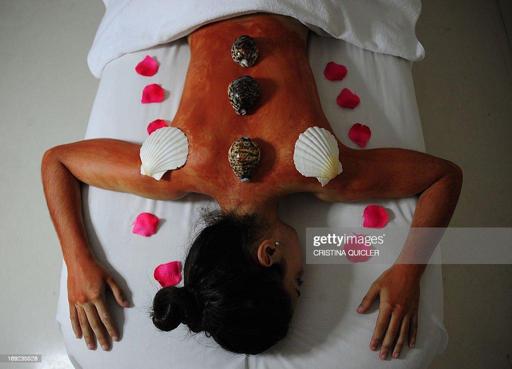 A woman receives a beauty treatment at the 'Carmen Navarro' luxury beauty center in Sevilla, on May 20, 2013.