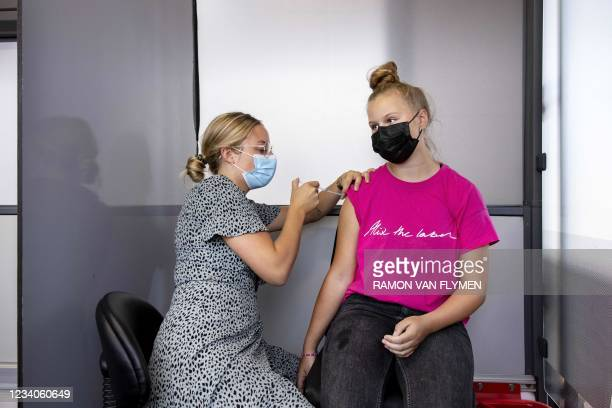 Woman receives a dose of a Covid-19 vaccine in a vaccination bus in Volendam, near Amsterdam, on July 19, 2021. - Netherlands OUT / Netherlands OUT