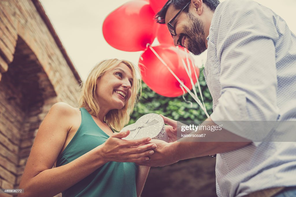 Woman receives a gift from her man : Stock Photo