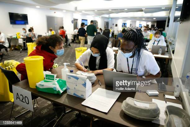 Woman receives a vaccine at the Chelsea F.C. Pop up vaccine hub on June 19, 2021 in London, England. Chelsea F.C. Is offering Covid-19 jabs to all...