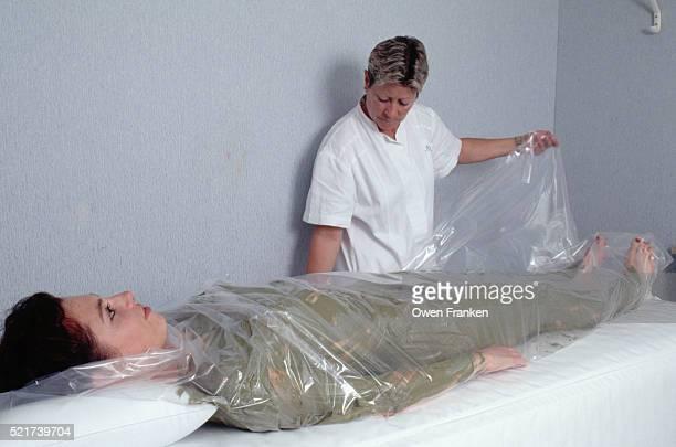 Woman Receives Algae Mud Therapy Treatment
