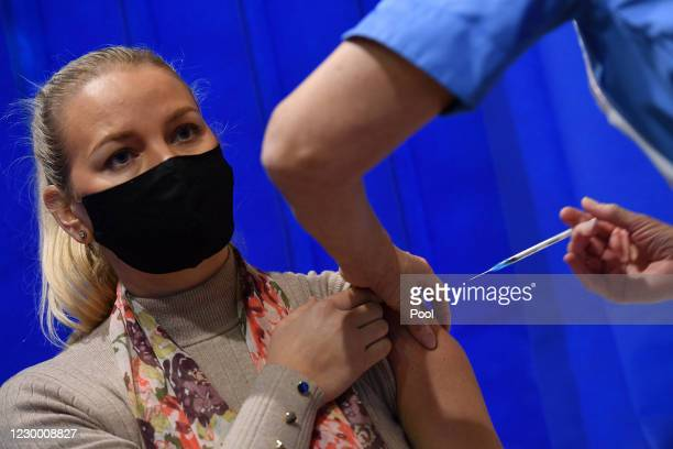 Woman receives an injection of the Pfizer-BioNTech Covid-19 vaccine at a health centre on the first day of the largest immunisation programme in the...