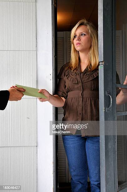 Woman Receives Hand-Delivered Document
