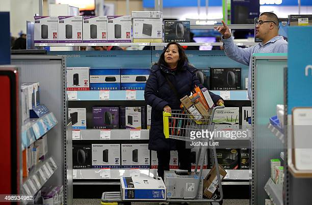 A woman receives help from a worker as she shops for electronics and other items at a Best Buy on November 27 2015 in Skokie Illinois Many retail...