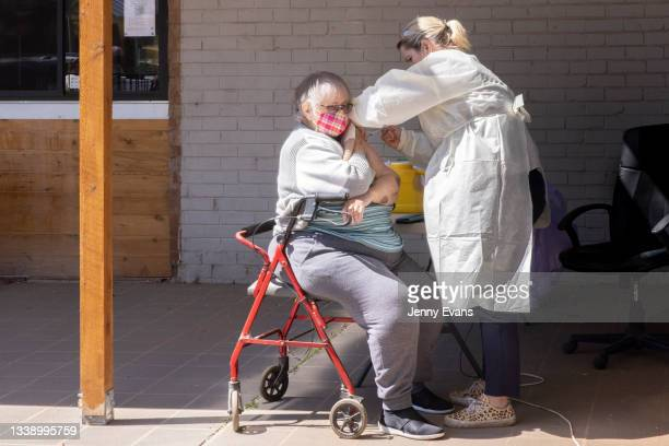 Woman receives her COVID-19 vaccination at a Pharmacy on September 08, 2021 in Narromine, Australia. New freedoms have been announced for fully...