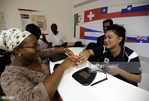 A woman receives her official 2010 FIFA World Cup tickets on April 15 2010 at the Maponya shopping mall in Soweto during the first day of the opening...