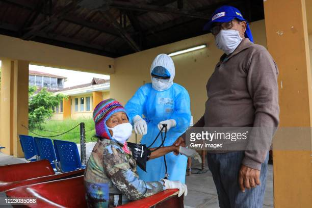 Woman receives medical assistance at Felipe Arriola Iglesias hospital on May 04, 2020 in Iquitos, Peru. Iquitos, capital city of the largest province...