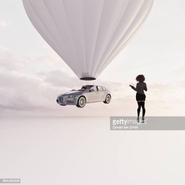 Woman receives new car being delivered by a hot air balloon