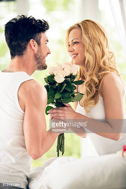 Woman receives roses in bed