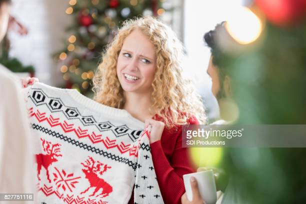 Woman receives ugly Christmas sweater at party