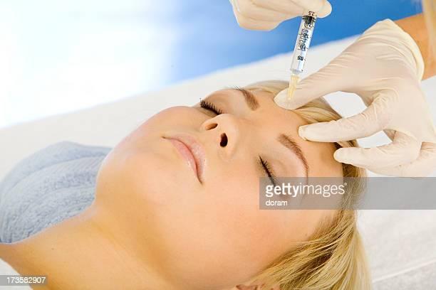 A woman receiving a Botox treatment