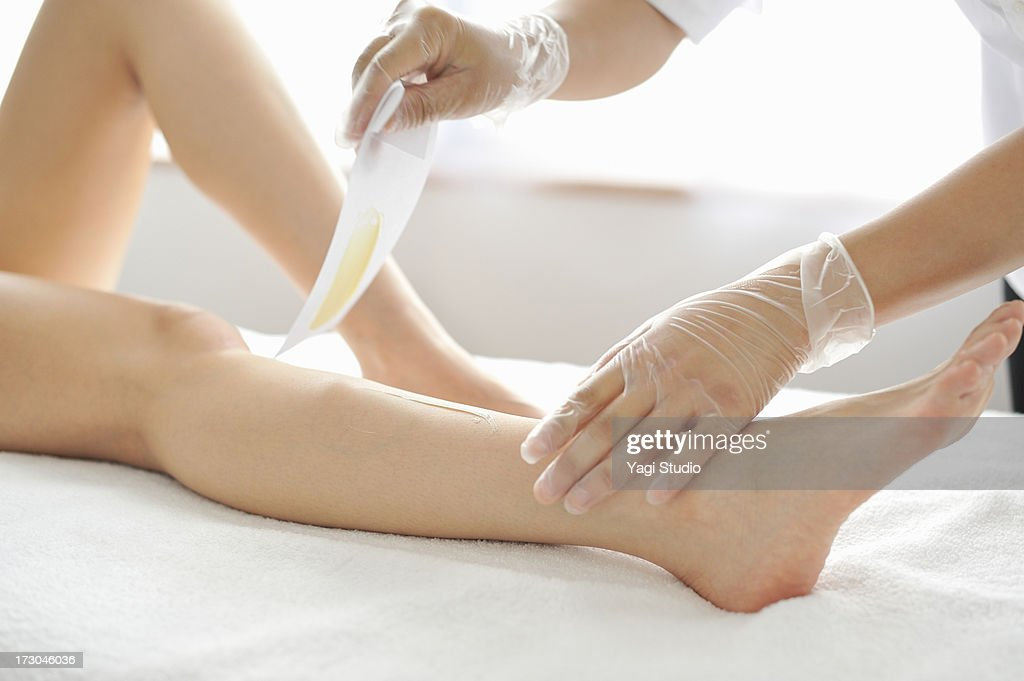 Woman Receiving A Brazilian Wax Hair Removal Stock Photo