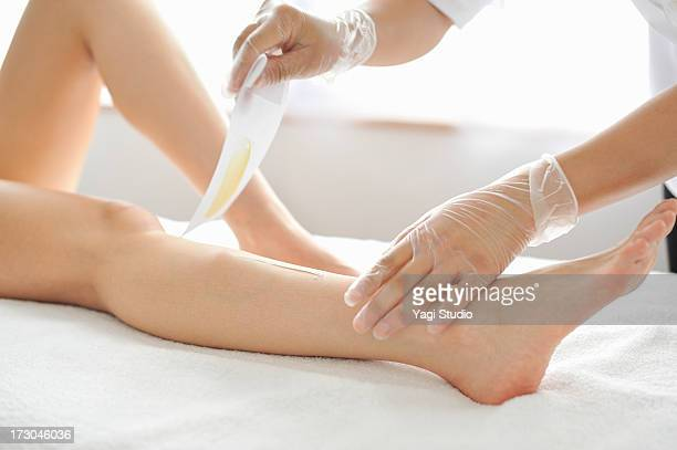 woman receiving a brazilian wax hair removal - images of brazilian wax stock pictures, royalty-free photos & images