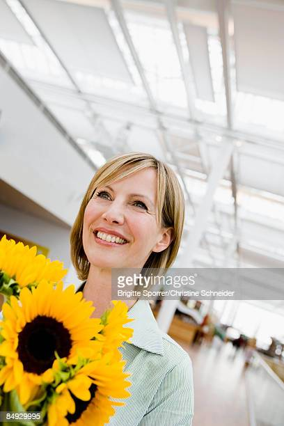 Woman receiving a bunch of flowers