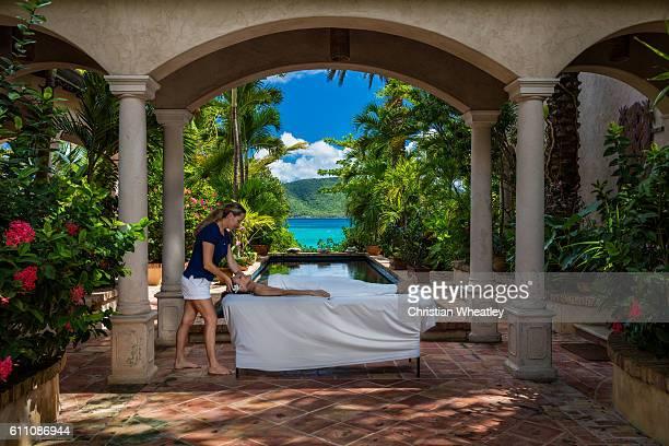 woman receiving a massage at a beautiful villa in Caribbean