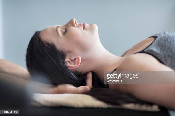woman receiving a massage - massage parlour stock photos and pictures