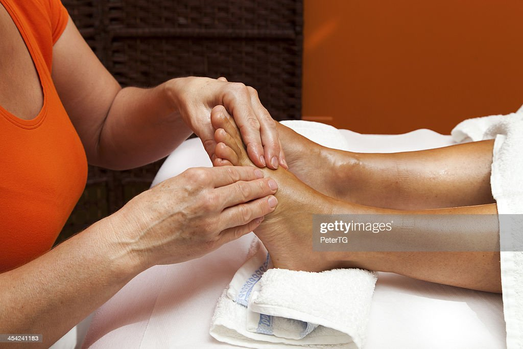 Woman receiving a professional masagge and lymphatic drainage various techniques : Stock Photo