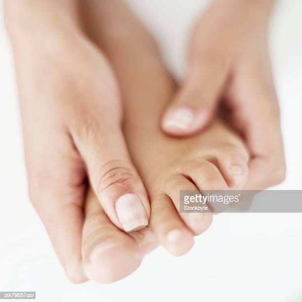woman receiving a reflexology massage