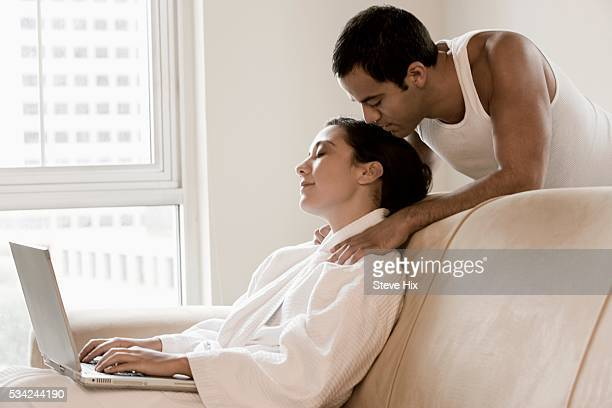 woman receiving a shoulder massage - husband massage wife stock photos and pictures