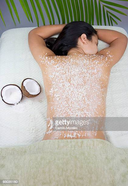 Woman receiving an organic scrub treatment