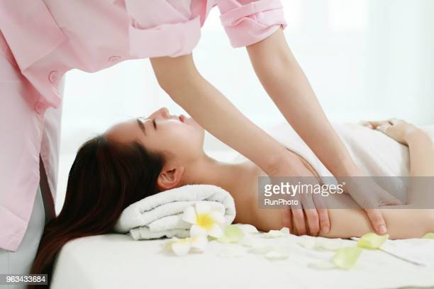 woman receiving arms massage - body massage japan stock pictures, royalty-free photos & images