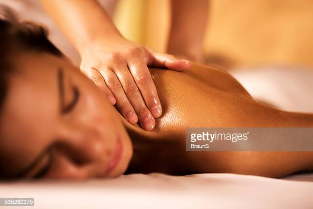 woman receiving back massage. - massage therapist stock pictures, royalty-free photos & images