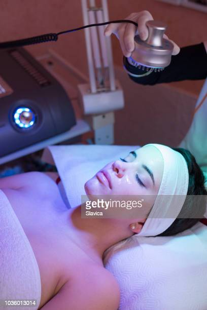 young woman receiving photon therapy health