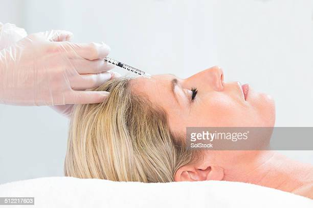 woman receiving botox injection - botox stock pictures, royalty-free photos & images