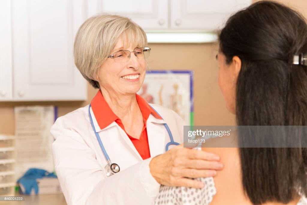 Woman receiving breast exam, mammogram at doctor's office or hospital. : Stock Photo