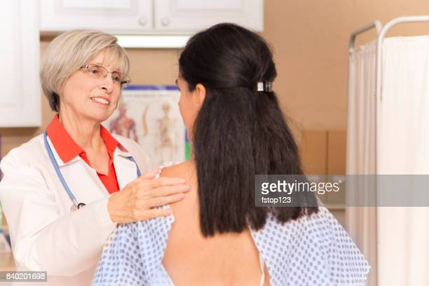 woman receiving breast exam, mammogram at doctor's office or hospital. - pelvic exam stock photos and pictures