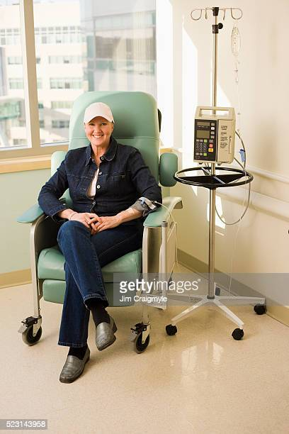 woman receiving chemotherapy treatment - chemotherapy stock pictures, royalty-free photos & images