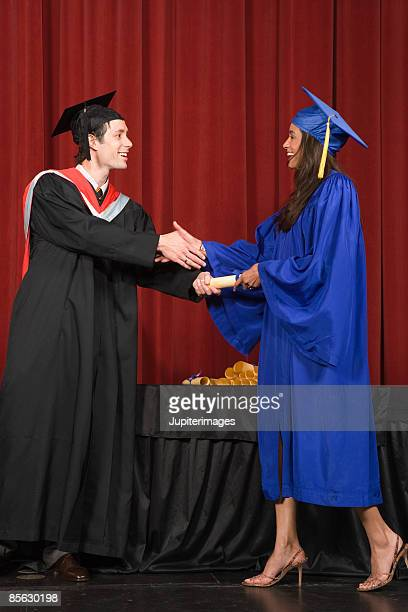 Woman receiving diploma on stage