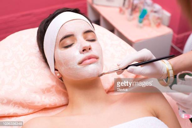 woman receiving facial mask treatment beauty