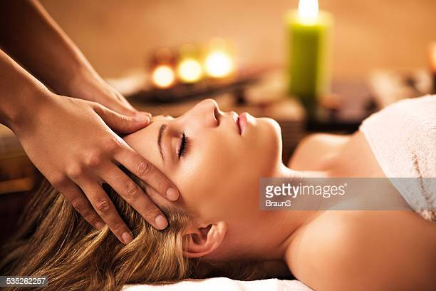 woman receiving facial massage. - head massage stock photos and pictures
