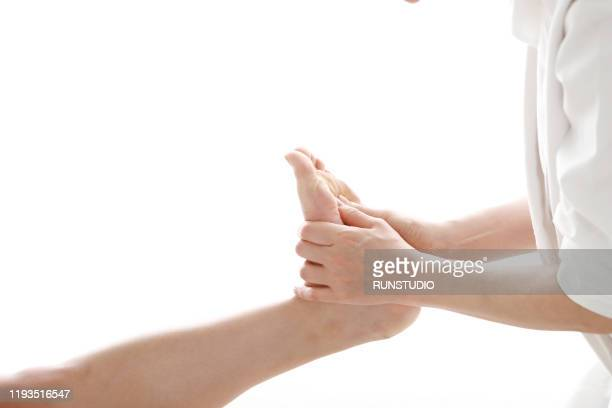 woman receiving foot massage - body massage japan stock pictures, royalty-free photos & images