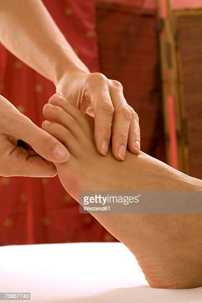 woman receiving foot massage - reflexology stock pictures, royalty-free photos & images