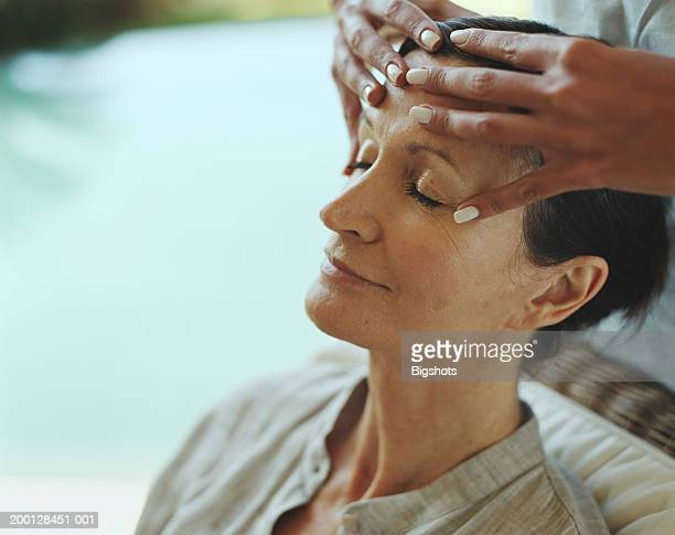 Woman receiving head massage, close-up