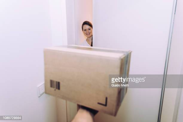 Woman receiving home delivery.