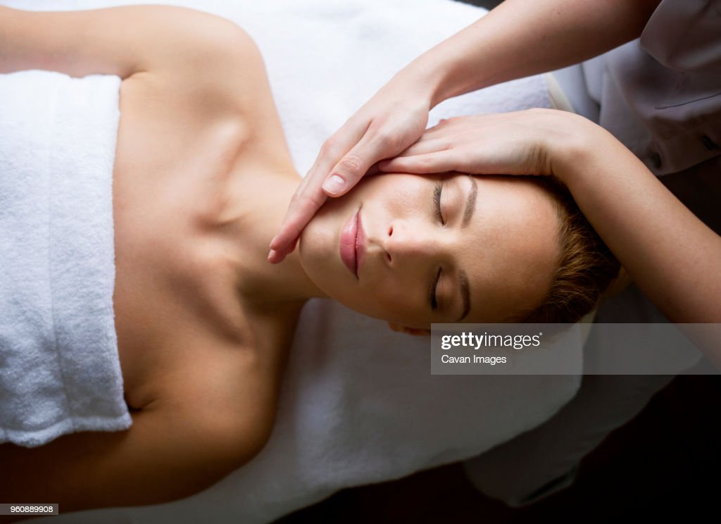 Woman receiving massage from female therapist in spa : Stock Photo