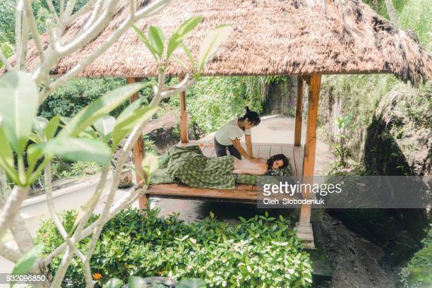 woman receiving  massage in bali - alternative therapy stock pictures, royalty-free photos & images