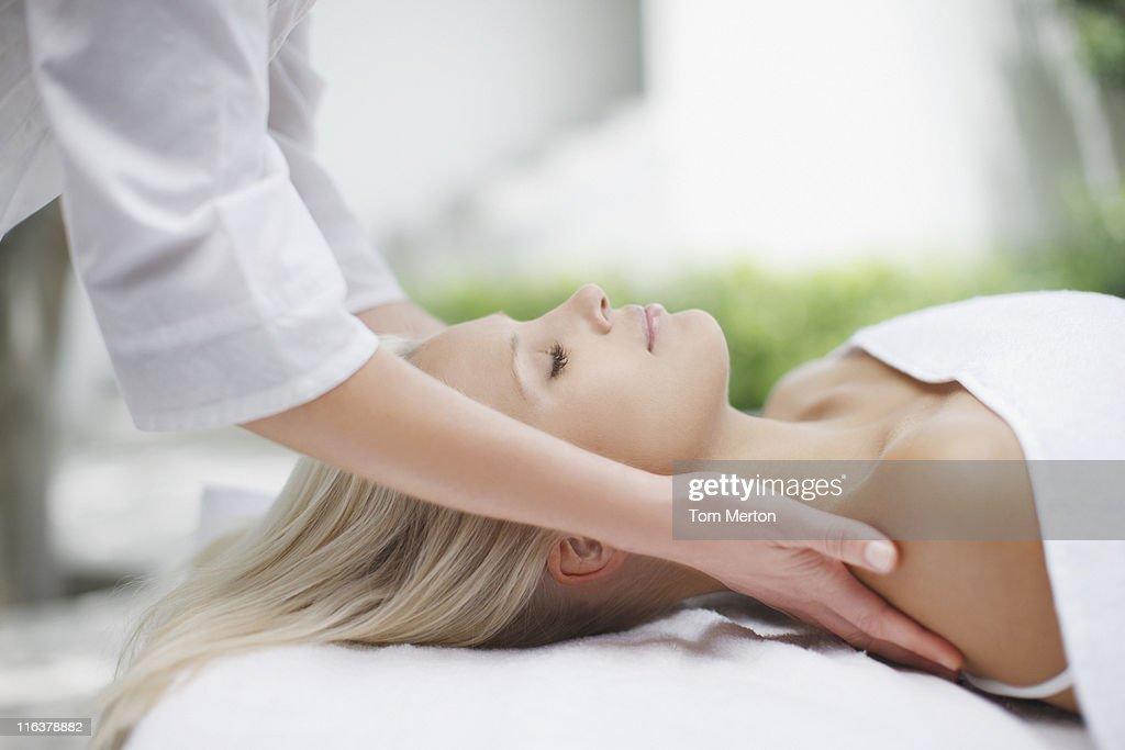 Woman receiving massage : Stock Photo