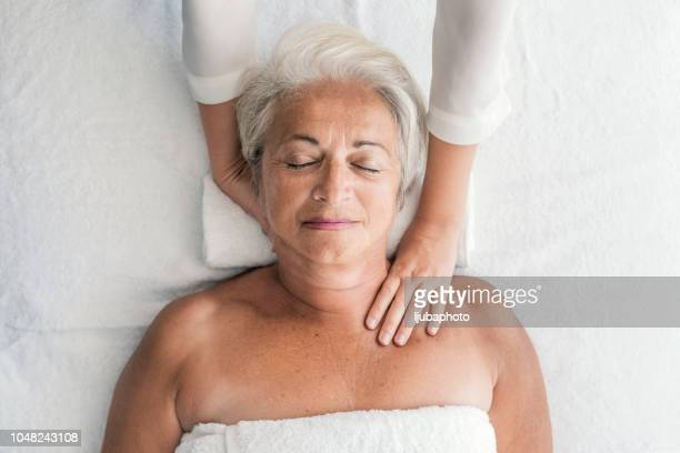 woman receiving neck massage - massaging stock pictures, royalty-free photos & images