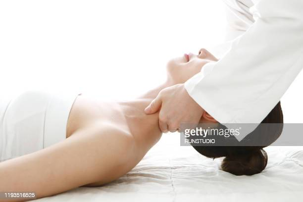 woman receiving neck massage - body massage japan stock pictures, royalty-free photos & images