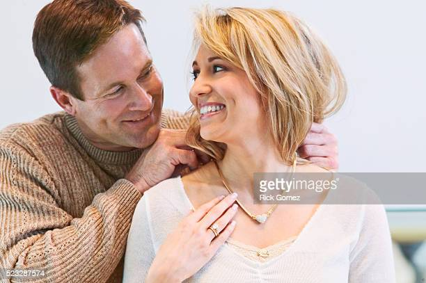 woman receiving necklace from man - choker stock pictures, royalty-free photos & images